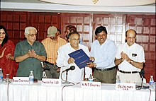 The Minister of Information & Broadcasting and Culture Shri S. Jaipal Reddy is being presented a report on National Film Awards - 2003 by the Head Jury ( Best writing on Cinema ) Shri K.N.T Sastry in New Delhi on August 14.jpg