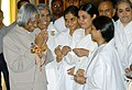 The President, Dr. A.P.J. Abdul Kalam thanking Brahma Kumaris after they tied Rakhi on the occasion of Raksha Bandhan in New Delhi on August 09, 2006.jpg