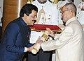 The President, Shri Pranab Mukherjee presenting the Padma Bhushan Award to Shri Udit Narayan Jha, at a Civil Investiture Ceremony, at Rashtrapati Bhavan, in New Delhi on April 12, 2016.jpg