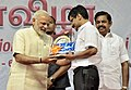 """The Prime Minister, Shri Narendra Modi presenting the Literary Award 2017 to Dr. V. Iraianbu for his book titled """"IIakkiyathil Melanmai"""", on the occasion of the Platinum Jubilee of the Daily Thanthi, in Chennai.jpg"""