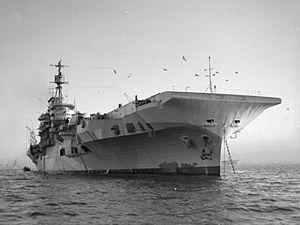 HMS Indefatigable (R10) - Water-level view of Indefatigable at anchor
