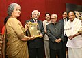 The Vice President, Mohammad Hamid Ansari presenting the first Dr. K Subrahmanyan Award to Smt. Sudha Mahalingam, an Energy Specialist and a distinguished scholar of International Affairs, instituted by the IDSA.jpg