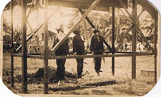 United States war crimes - Execution of Moros illustrated on a 1911 commemorative postcard