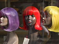 Three mannequin heads in brightly-colored wigs.jpg