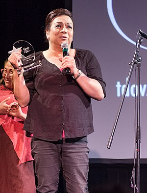 Tita Aida - Tita Aida receives an award at the 2016 Trans Day of Visibility celebration in San Francisco.