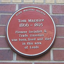 Photo of Tom Maguire red plaque