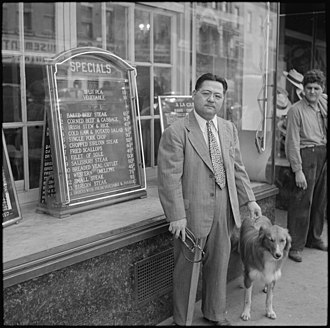 James Hatsuaki Wakasa and his dog in an undated photograph. A 63-year-old chef from San Francisco, Wakasa was shot and killed by a military sentry while walking his dog inside the barbed-wire fence. Topaz, Utah. James Wakasa funeral scene. (The man shot by military sentry). - NARA - 539611.jpg