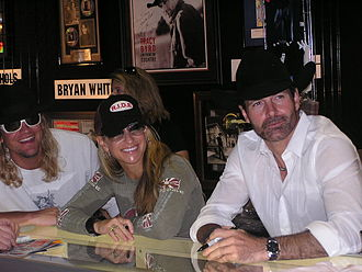 CMA Music Festival - Ira Dean, Heidi Newfield, and Keith Burns of Trick Pony signing autographs at the CMA Music Festival in 2006. (Photo by Tiffany Scott of Sister Sisters Photography)