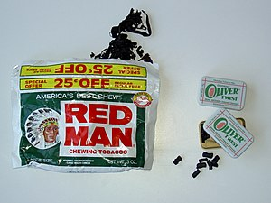 Tobacco products - A pouch of Red Man loose leaf chewing tobacco and Oliver Twist tobacco bits/pellets.