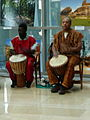 Two drummers playing djembe drums embassy of nigeria 2001.jpg