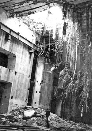 Bunker buster - A U-Boat pen after being hit by a Grand Slam. There is a figure standing on the pile of rubble.