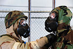 U.S. Air Force Senior Airman Hugh Blacketor, left, a heating, ventilation, and air conditioning journeyman assigned to the 28th Civil Engineer Squadron, removes simulated contaminated gear of Airman 1st Class 100824-F-VO466-095.jpg