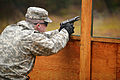 U.S. Army Pfc. Joshua James, assigned to the 615th Military Police (MP), 18th MP Brigade, fires an M9 pistol during weapons qualification at the 7th Army Joint Multinational Training Command's (JMTC) Grafenwoehr 140113-A-HE359-038.jpg