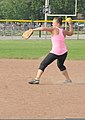 U.S. Coast Guard Lt. j.g. Katie Pierson, a cutter operations officer with the 9th Coast Guard District Prevention Department in Cleveland, throws to third base during her unit's softball practice July 31 130731-G-KB946-047.jpg