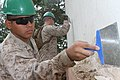 U.S. Marine Corps Pfc. Luis A. Maranon, left, with the 9th Engineer Support Battalion, scrapes emulsion off a wall during renovation work at Erdmiin Oyun High School in Nalaikh district, Ulaanbaatar, Mongolia 130721-M-DR618-066.jpg
