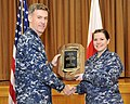 U.S. Navy Capt. Chris Rodeman, left, the commanding officer of Naval Air Facility Misawa, presents Mass Communication Specialist 3rd Class Erin Devenberg with a plaque from the Navy's chief of information 140109-N-ZI955-020.jpg