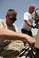 U.S. Navy Construction Mechanic 1st Class William Cook, assigned to Construction Battalion Maintenance Unit 202, attached to the Khost Provincial Reconstruction Team, and Brian Coll, a force protection Cougar 120811-A-PO167-024.jpg