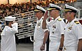 U.S. Navy Rear Adm. James F. Caldwell Jr., second from right, commander of Submarine Force U.S. Pacific Fleet, salutes Seaman Recruit Ku Vang during the pass in review portion of a graduation ceremony in the USS 120518-N-IK959-908.jpg