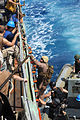 U.S. Sailors and Marines with the visit, board, search and seizure team, currently assigned to the guided missile cruiser USS San Jacinto (CG 56), climb onboard from a rigid hull inflatable boat, after 100524-N-EF447-263.jpg