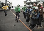 U.S. Sailors participate in a firefighting drill on the flight deck of the aircraft carrier USS Dwight D. Eisenhower (CVN 69) in the U.S. 5th Fleet area of responsibility June 6, 2013 130606-N-XQ474-101.jpg