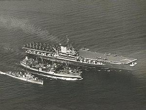 USS Chukawan (AO-100) refuels USS Midway (CVB-41) and USS John R. Pierce (DD-753), in 1950