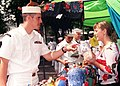 US Navy 020810-N-8955H-005 A Sailor asks a local merchant for the price of a souvenir.jpg