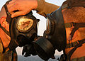 US Navy 030115-N-4048T-027 Marines assigned to the 2nd Marine Expeditionary Brigade home-based at Camp LeJeune, NC., don their gas masks to ensure that they fit properly while training aboard amphibious assault ship.jpg