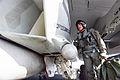 US Navy 030125-N-6817C-005 pilot inspects the intake of an F-A-18E.jpg