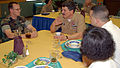 US Navy 030331-N-4843P-001 Master Chief Petty Officer of the Navy (MCPON) Terry Scott speaks with Hospital Corpsman 1st Class Weston R. Wright, during a luncheon with sailors at Camp Shields Crows Nest.jpg