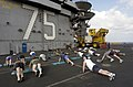 US Navy 030420-N-4308O-061 Sailors exercise with the Explosive Ordinance Disposal (EOD) team in front of the island structure on the flight deck aboard USS Harry S. Truman (CVN 75).jpg