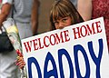 US Navy 030708-N-5576W-001 The daughter of Gunnery Sgt. Gary Jacobs awaits for her Dad's return from Operation Iraqi Freedom.jpg