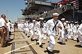 US Navy 030712-N-8295E-420 Crewmembers of the Navy's newest Nimitz-class aircraft carrier USS Ronald Reagan (CVN 76) keep with the Navy tradition of running up the gangplanks to bring the ship to life.jpg