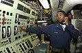 US Navy 030816-N-2613R-002 Gas Turbine System Technician 3rd Class Vaughn from Memphis Tenn., checks a High temperature alarm indicator on one alpha gas turbine generator aboard the Spruance-class destroyer USS Cushing (DD 985).jpg