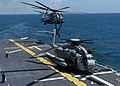 US Navy 040610-N-6208N-003 CH-53E Super Stallion helicopters assigned to Marine Heavy Helicopter Squadron Four Six Four (HMH-464) take off from the flight deck of the amphibious assault ship USS Kearsarge (LHD 3).jpg