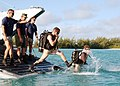 US Navy 040709-N-0000H-001 U.S. Navy Seabees, Constructionman 1st Class James Richardson steps into the water one step behind fellow diver Constructionman 1st Class Steven Hentze at the beginning of a scheduled dive.jpg