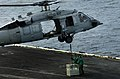 US Navy 040917-N-5024R-002 An MH-60S Knighthawk gets in position to picks up cargo from the flight deck of the aircraft carrier USS John C. Stennis (CVN 74).jpg