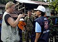 US Navy 050117-N-0057P-003 Lucy Mize of the United Nations (UN) World Health Organization (WHO), speaks with a member of the Salvation Army about condition of local inhabitants.jpg
