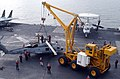 US Navy 050204-N-7405P-045 Flight deck personnel aboard the Nimitz-class aircraft carrier USS Harry S. Truman (CVN 75) conduct aircraft salvage training with the emergency heavy lift crane, nicknamed Tilly, while underway in th.jpg