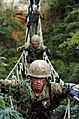 US Navy 050225-N-9712C-002 U.S. Marines cross a three-strand bridge at the beginning of the endurance course at the Jungle Warfare Training Center on board Camp Gonslaves, Okinawa.jpg