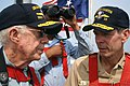 US Navy 050811-N-0653J-003 Former President Jimmy Carter speaks with Commander, Submarine Force, U.S. Atlantic Fleet, Vice Adm. Charles Munns, as they ride out to sea on the bridge aboard the Sea Wolf-class attack submarine USS.jpg