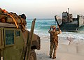 US Navy 050928-N-0716S-032 U.S. Navy Gunner's Mate 2nd Class Daniel Graves, assigned to Beach Masters Unit One (BMU-1), guides a Landing Craft, Utility onto an Egyptian beach.jpg