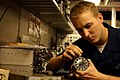 US Navy 051103-N-5832A-001 Aviation Electronics Technician Airman Lloyd Edward switches the motor of a bearing distance height indicator (BHDI) in an Aircraft Intermediate Maintenance Department (AIMD) workshop.jpg