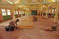US Navy 051224-N-4374S-004 U.S. Navy Seabees, assigned to Naval Mobile Construction Battalion Three (NMCB-3), conduct floor restoration project at the Providence Hall in St. Elisabeth Convent, a daycare center in Seychelles.jpg