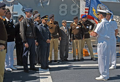US Navy 060406-N-0640K-013 USS Bunker Hill (CG 52) Commanding Officer, Capt. Charles M. Gaouette, talks with members of the National Pakistan Defense College