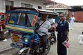 US Navy 060601-N-9076B-105 Navy Petty Officer 3rd Class Adelaida Sojo hands out American flags to local Filipinos at the Zamboanga Medical Center during the Military Sealift Command (MSC) Hospital ship USNS Mercy's (T-AH 19) vi.jpg