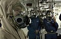 US Navy 060617-N-9851B-006 Seaman Christopher Smith wears an Advanced Chemical Protective Garment (ACPG) before exiting the skin of the ship as part of an external investigation team.jpg