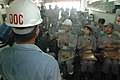 US Navy 060901-N-1332Y-353 Hospital Corpsman 1st Class Juan Brebonerta supervises as Tokyo Metropolitan Government employees are instructed on how to prepare a meal-ready-to-eat (MRE), during a disaster drill.jpg