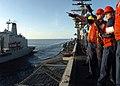 US Navy 061127-N-8907D-004 Sailors aboard the Nimitz-class aircraft carrier USS Dwight D. Eisenhower (CVN 69) discuss where to fire the shot line during a underway replenishment.jpg