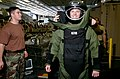 US Navy 070209-N-4009P-160 Explosive Ordnance Disposal Technicians (EOD) dress Aircrew Survival Equipmentman 3rd Class Dusty Rather from Houston, Texas, in a bomb suit during an EOD recruitment session.jpg