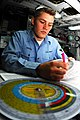 US Navy 070425-N-9928E-054 Aerographer's Mate 3rd Class Anthony Valence converts the ships course, speed and relative winds to find true winds in operations department's metrological division.jpg